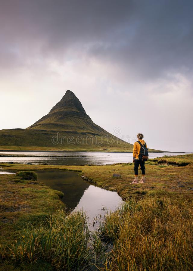 Free Young Hiker With A Backpack Looks At The Kirkjufell Mountain In Iceland Royalty Free Stock Photography - 165908797
