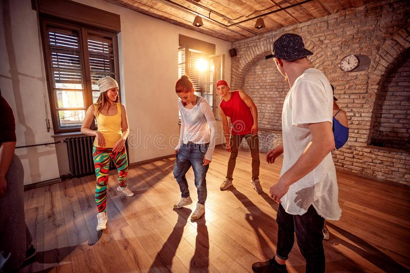 Young hip hop dancers dancing in the studio. Sport, dancing and. Group of young hip hop dancers dancing in the studio. Sport, dancing and urban culture concept stock images