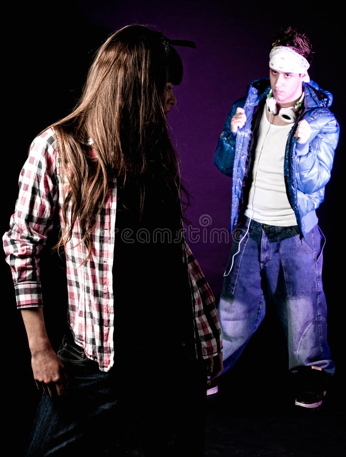 Young hip-hop man try to pick up a girl at disco stock photography