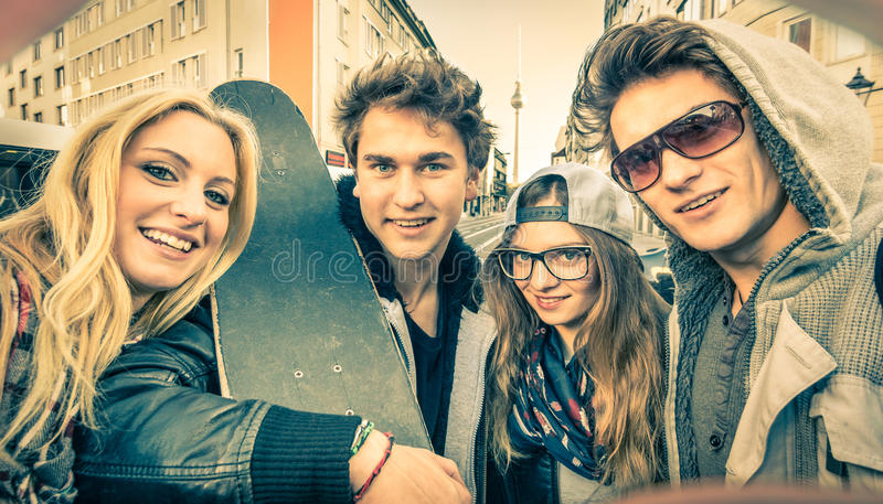 Young hipster best friends taking a selfie in urban city context stock photos