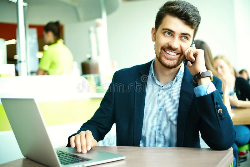 Young hipster businessman in cafe with notebook in suit stock photos
