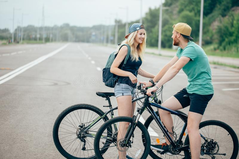 Young hipster couple holding hands standing on road royalty free stock photography