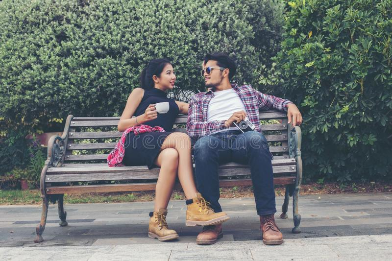 Young hipster couple teenagers in love in the city, Summer holiday enjoyment together stock photos