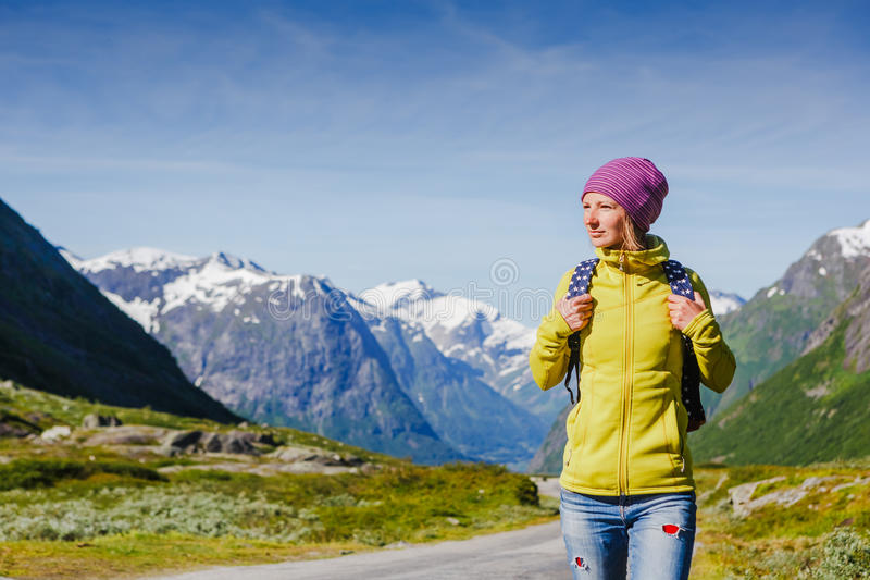 Young hipster female traveler on road. Adventure is coming stock image