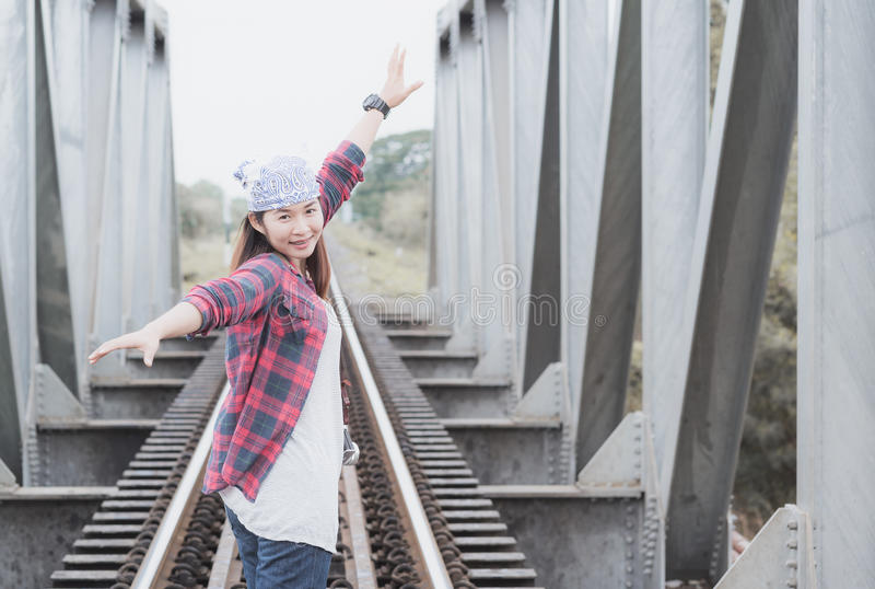 Young hipster female traveler smile and enjoy the travel. On vintage tone. concept Adventure and vacation stock photo
