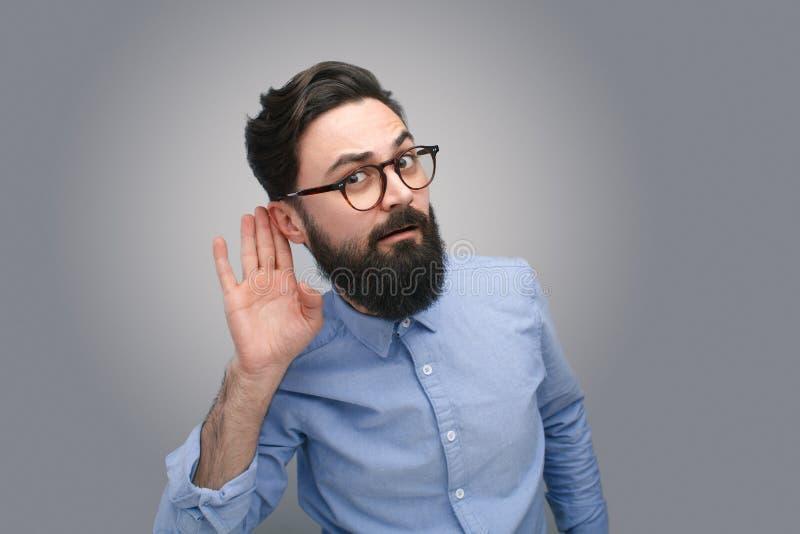 Bearded man listening to rumors royalty free stock photo