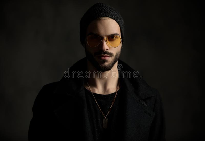 Young hipster looking confident with orange sunglasses royalty free stock photo