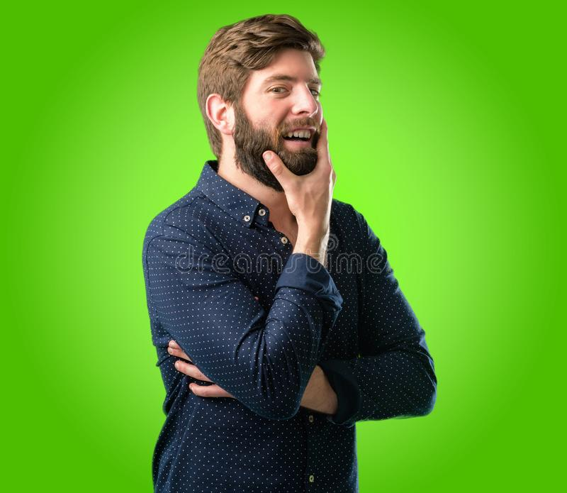 Young hipster man with beard and shirt stock photography