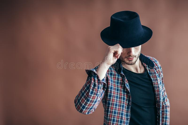 Young hipster man wearing hat posing with copy space royalty free stock photography