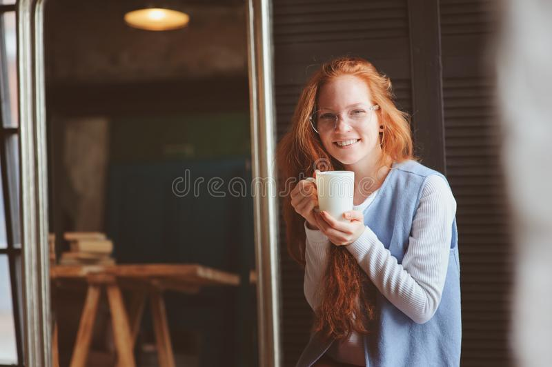 Young hipster student woman or creative freelance designer on the work. Morning in home office or art studio. Young beautiful hipster student woman or creative stock image