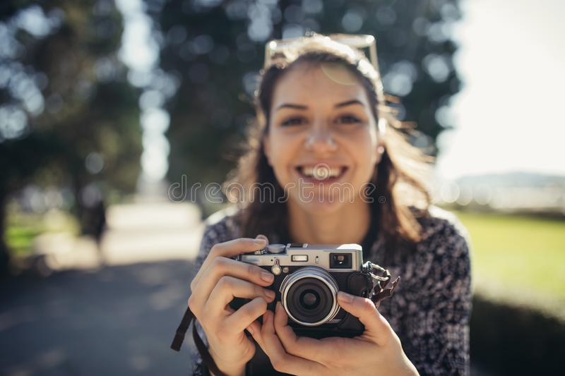 Young hipster tourist street photographer visiting colourful Lisbon.Enjoying colourful and busy city life royalty free stock photo