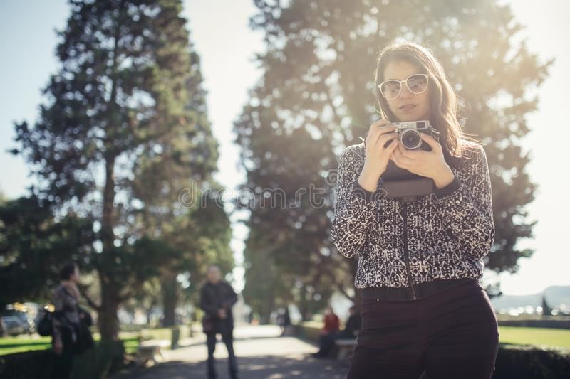 Young hipster tourist street photographer visiting colourful Lisbon.Enjoying colourful and busy city life royalty free stock photos