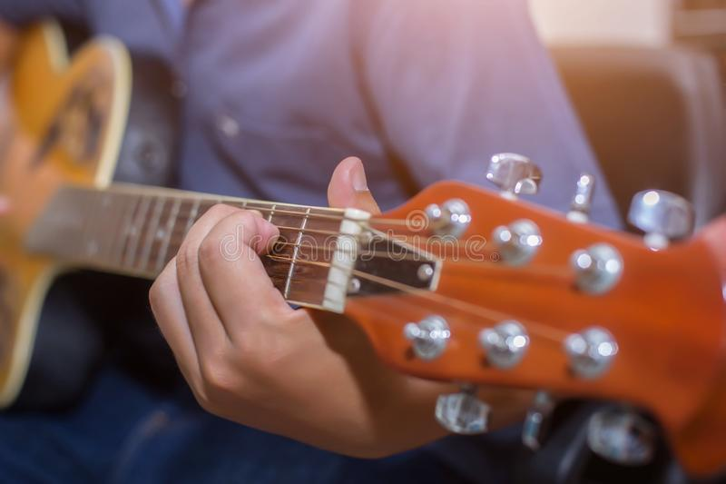 Close up of young hipster woman practiced guitar in the park,happy and enjoy playing guitar royalty free stock images