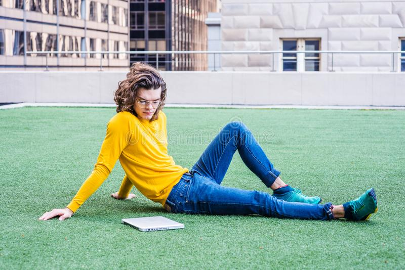 Young Hispanic American College Student Studying in New York. Young Hispanic American College Student thinking outside in New York, with brown curly hair royalty free stock photos