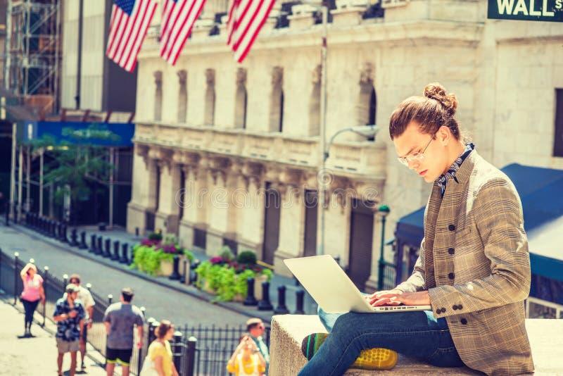 Young Hispanic American Male College Student traveling, studying. Young Hispanic American College Student traveling, studying in New York City, with hair bun stock photography