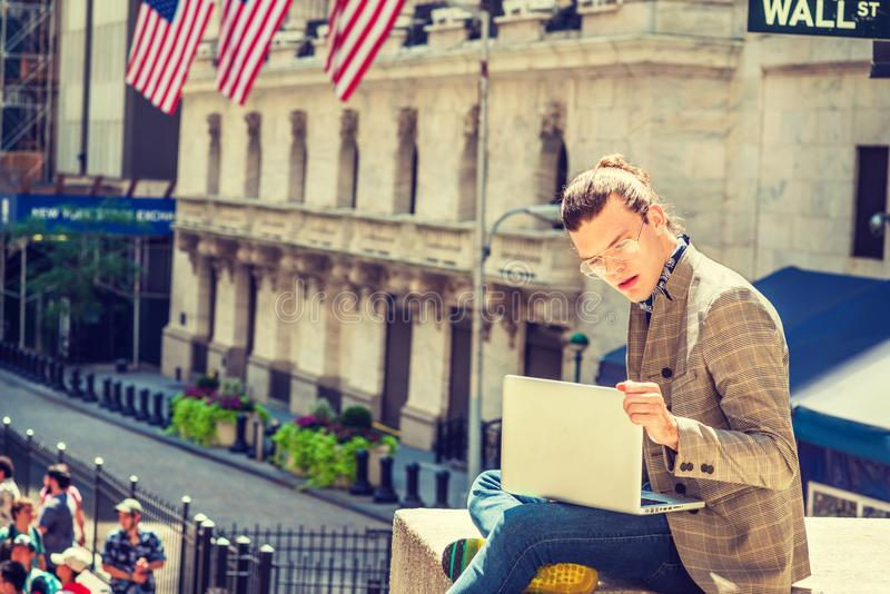 Young Hispanic American Male College Student traveling, studying. Young Hispanic American College Student traveling, studying in New York City, with hair bun stock images