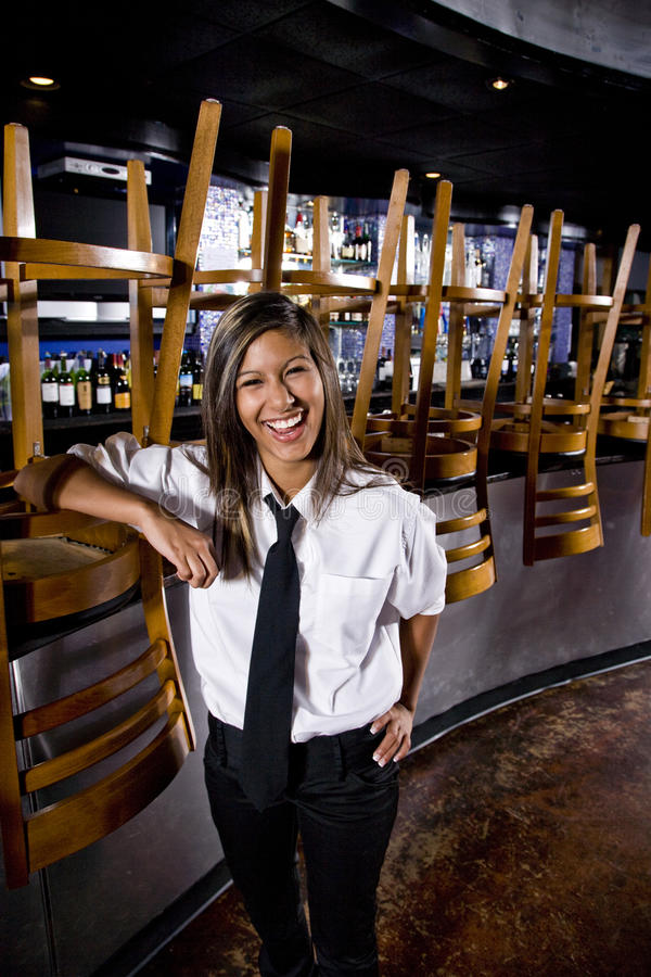 Young Hispanic Bartender Standing In Closed Bar Stock Images