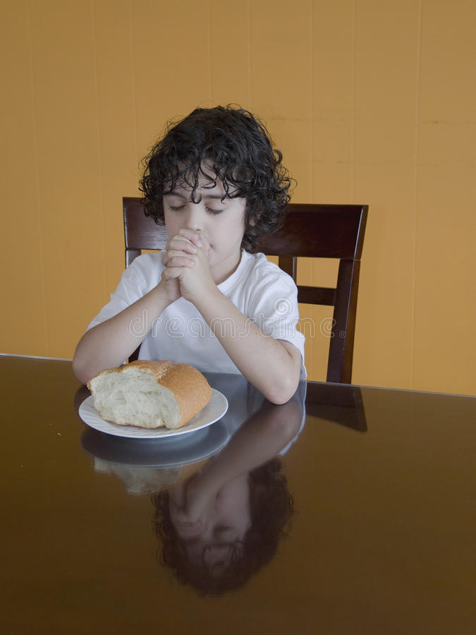 Young Hispanic Boy Praying for the Food royalty free stock images