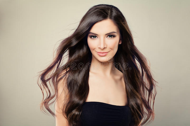 Young Hispanic Fashion Model Woman with Brown Blowing Hair royalty free stock photo