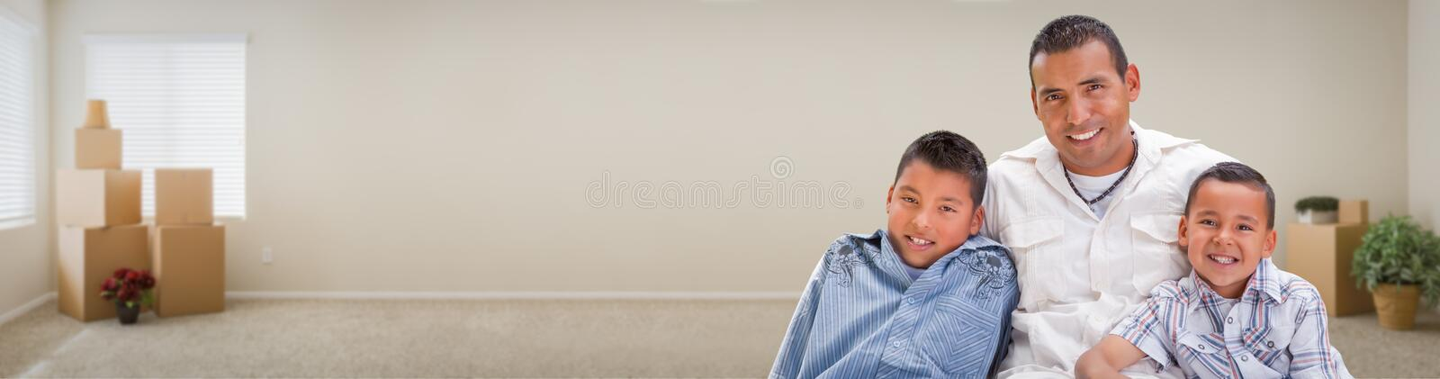 Young Hispanic Father and Sons Family Inside Room with Boxes Ban royalty free stock photos