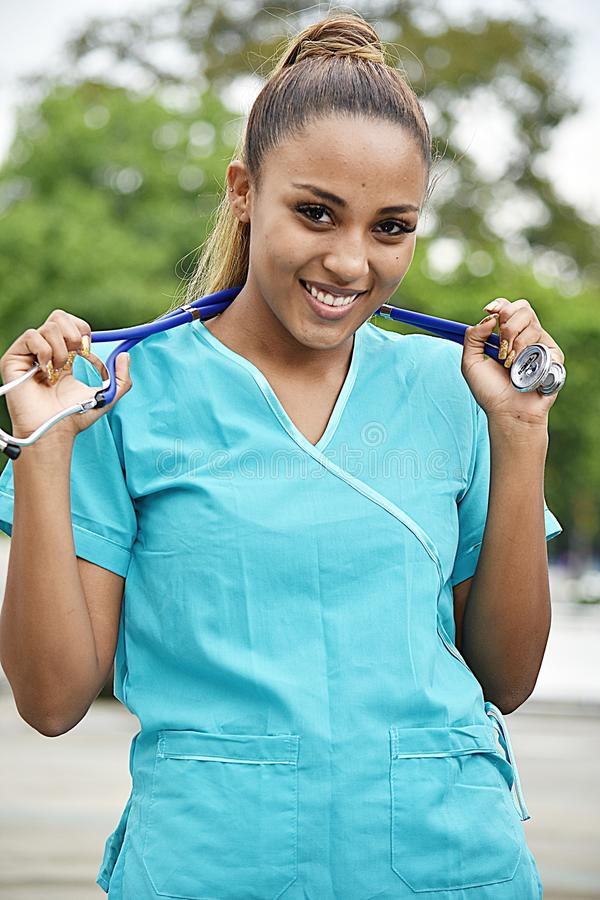 Young Hispanic Female Nurse. A young pretty Colombian teenage girl stock photography
