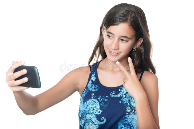 Young hispanic girl taking herself a portrait royalty free stock photography