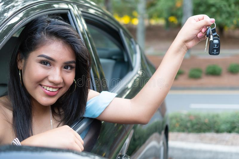 Young hispanic teenage girl learning to drive royalty free stock photos