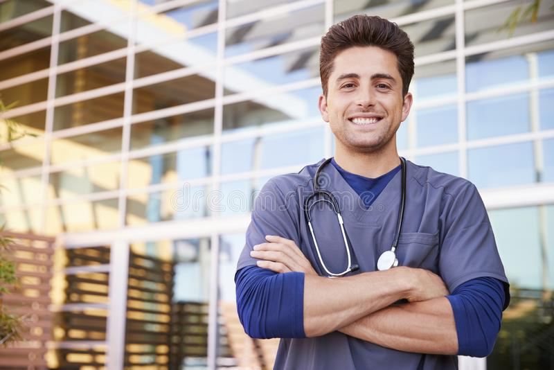 Young Hispanic male healthcare worker outdoors, portrait stock image