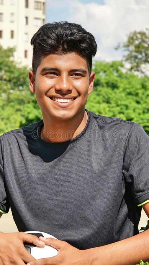 Young Hispanic Male Soccer Player Smiling Stock Image