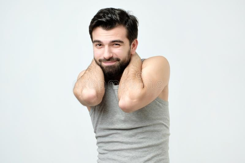 Young hispanic man with beard is feeling guilty. stock photos