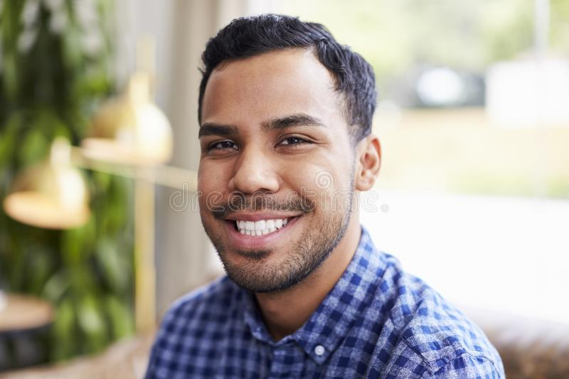 Young Hispanic man in coffee shop smiling to camera stock photography