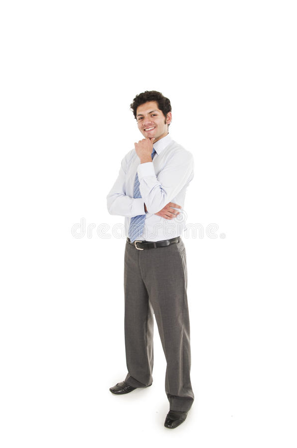 Young hispanic man wearing shirt and blue tie. Posing with hand on chin isolated on white stock photography