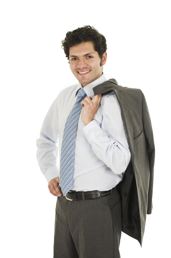 Young hispanic man wearing shirt and blue tie. Posing with jacket over the shoulder isolated on white royalty free stock photography