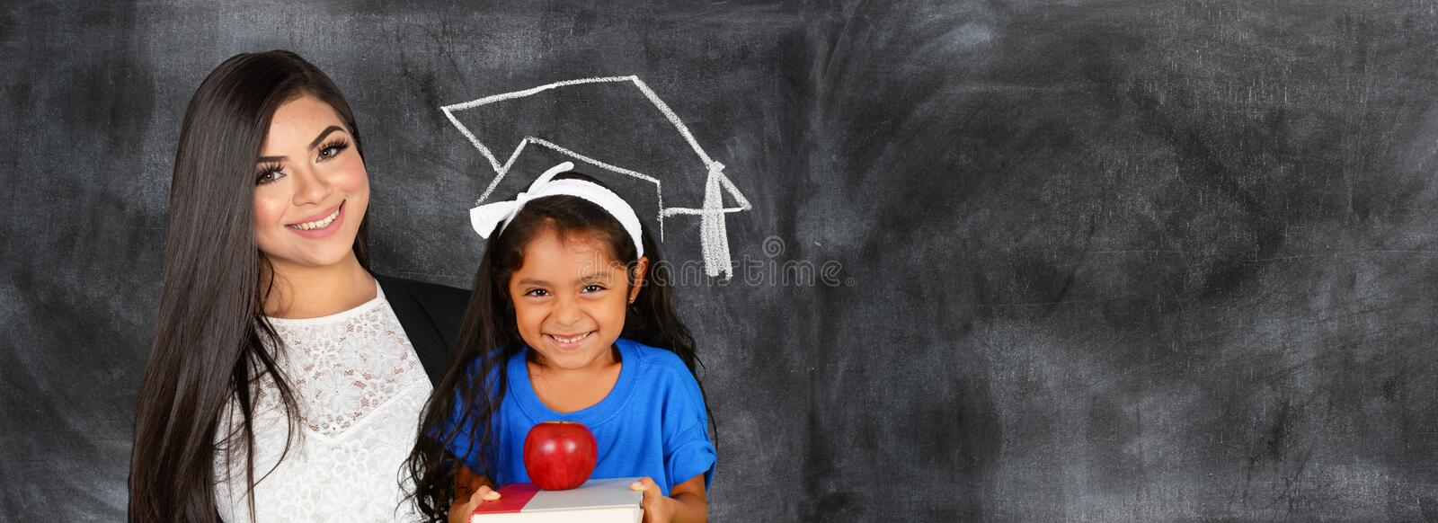 Hispanic Teacher With A Student At School royalty free stock photography