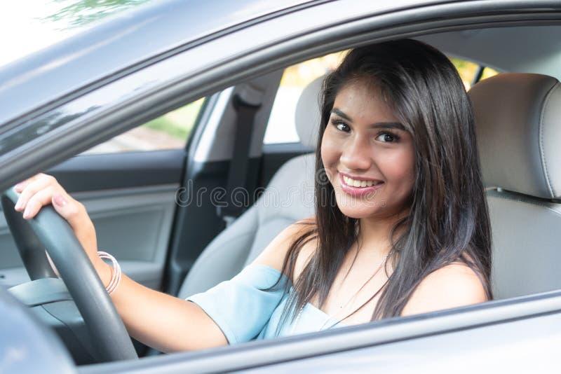 Young hispanic teenage girl learning to drive stock photo