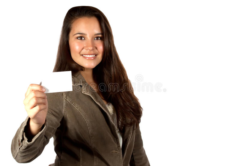 Young Hispanic woman holding a blank business card. Young, beautiful hispanic female, with long hair, holding a blank business card royalty free stock photos