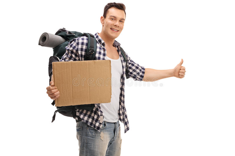 Young hitchhiker holding a blank cardboard sign. Isolated on white background royalty free stock photos