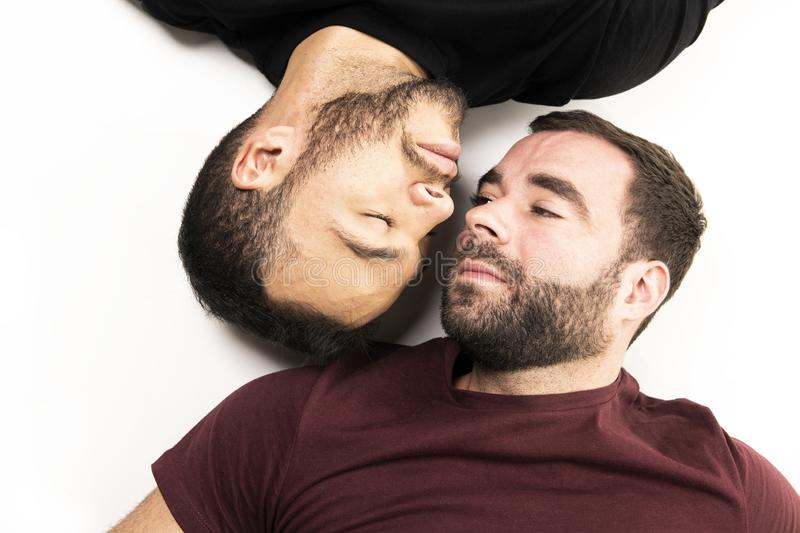Young homosexuals gay couple love each other on a white background. stock photo