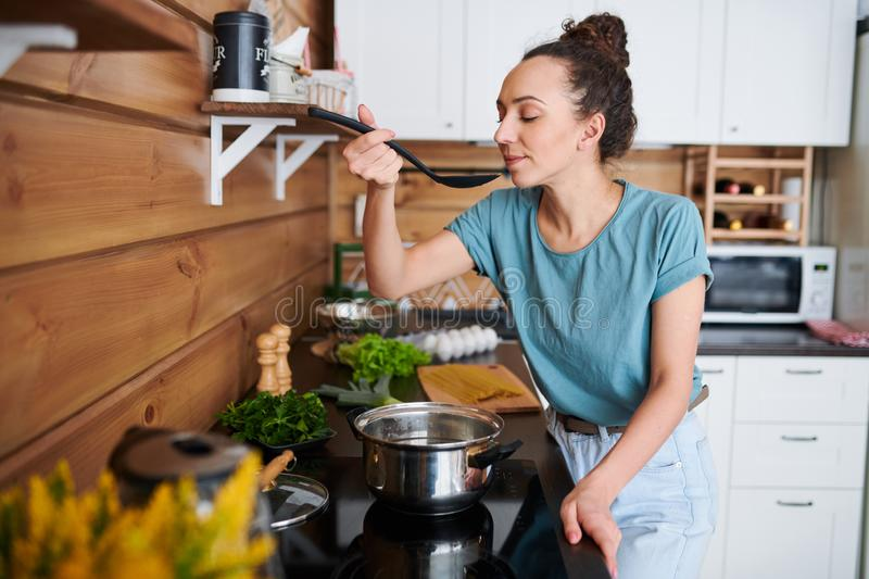 Woman cooking stock image