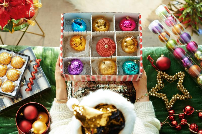 Young housewife took out Christmas ornaments to decorate house royalty free stock photos