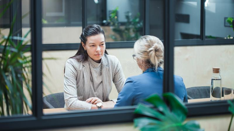 Young HR woman interviews a candidate for a job. royalty free stock image