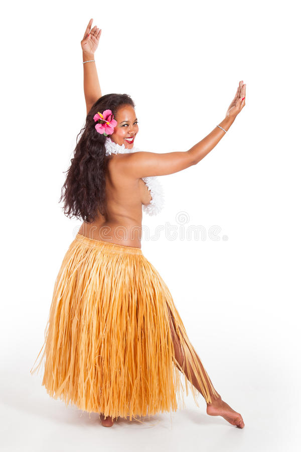 Young hula dancer looking over her shoulder. A young hula dancer looks over her shoulder at the audience stock image