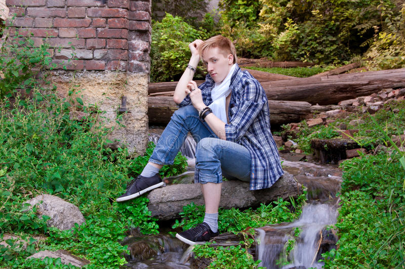 Download Young Human Is Siting Among Greenery Stock Photo - Image: 21046036