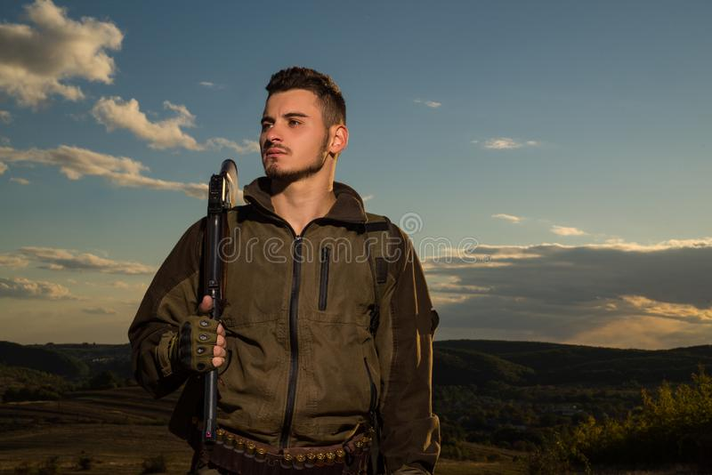 Young hunter. American hunting rifles. Hunting without borders. Hunter with shotgun gun on hunt. Portrait of handsome stock photos
