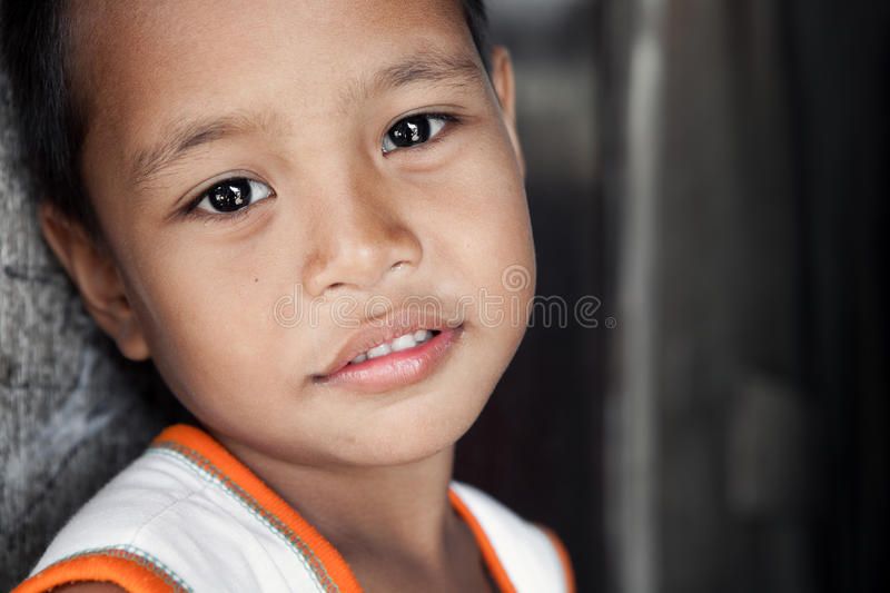 Young impoverished Asian boy portrait royalty free stock photos