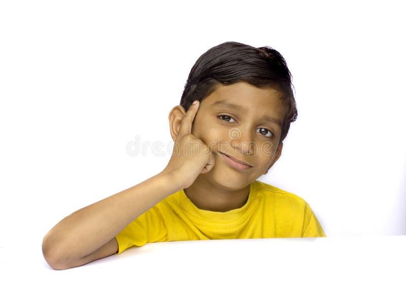 Young Indian boy. Thinking something royalty free stock photos