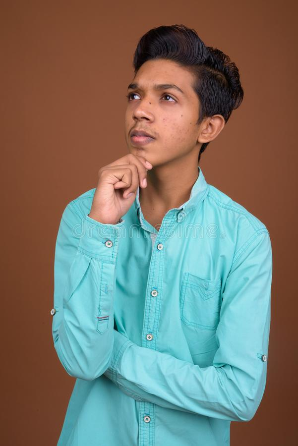 Young Indian Boy Wearing Blue Shirt Looking Smart Against