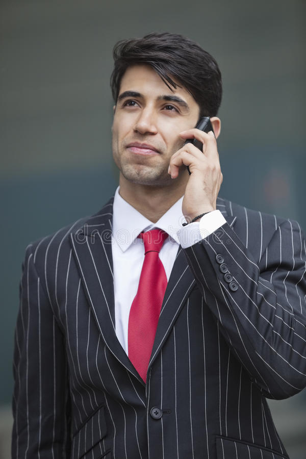Young Indian businessman communicating on cell phone stock photos