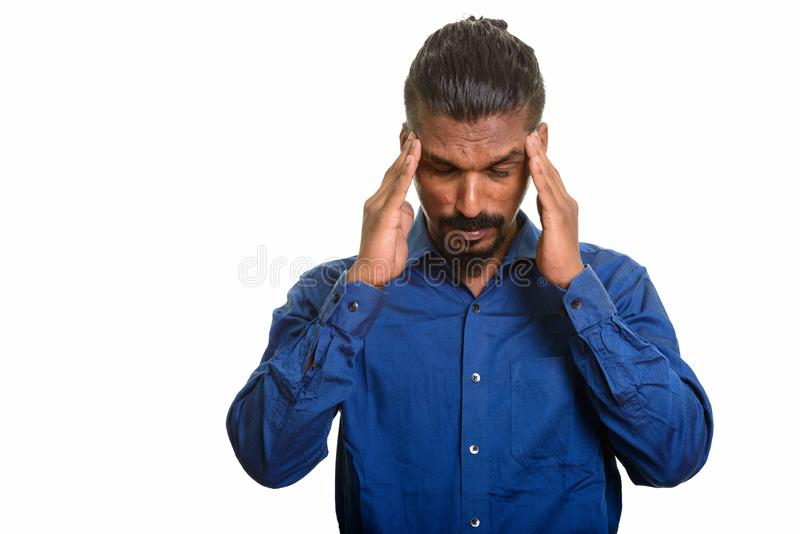 Young Indian businessman having headache studio portrait against white background royalty free stock images