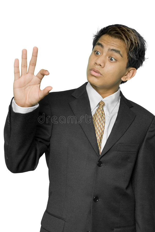 Download Young Indian Businessman Indicating Size Stock Image - Image: 7547617